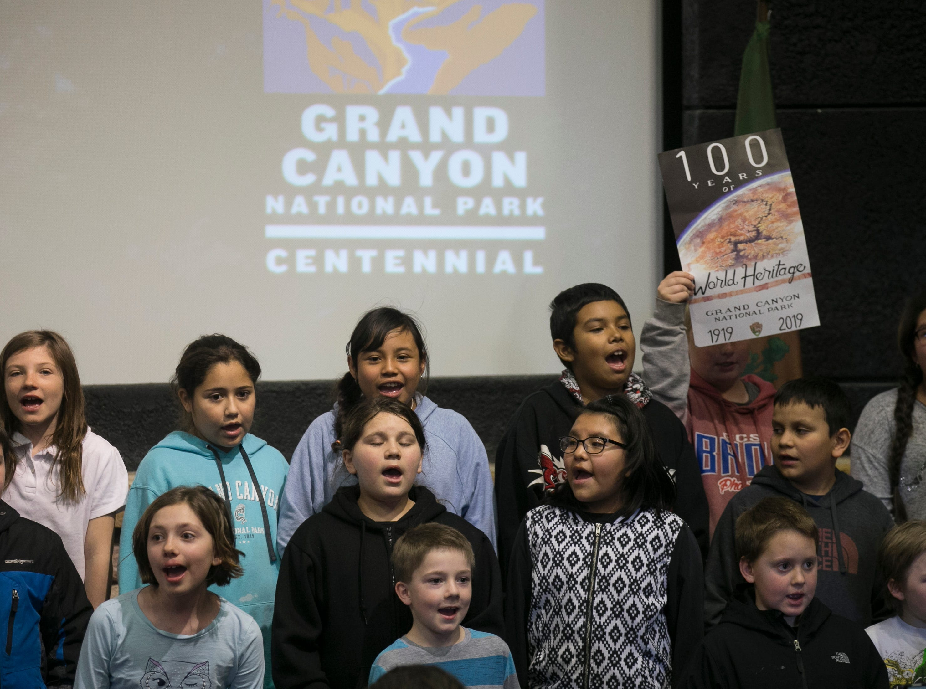 """Fourth-graders from Grand Canyon Elementary sing """"Happy Birthday"""" at the Grand Canyon during the park's 100th anniversary celebration on Feb. 26, 2019."""