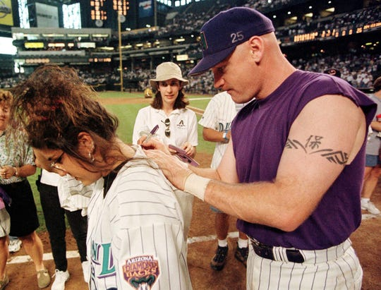 Matt Williams has been signing autographs for a long time. Here he signs during a fan appreciation event on Oct. 3, 1999, in Phoenix.