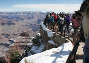 Visitors enjoy the Grand Canyon during the park's 100th anniversary celebration on Feb. 26, 2019.