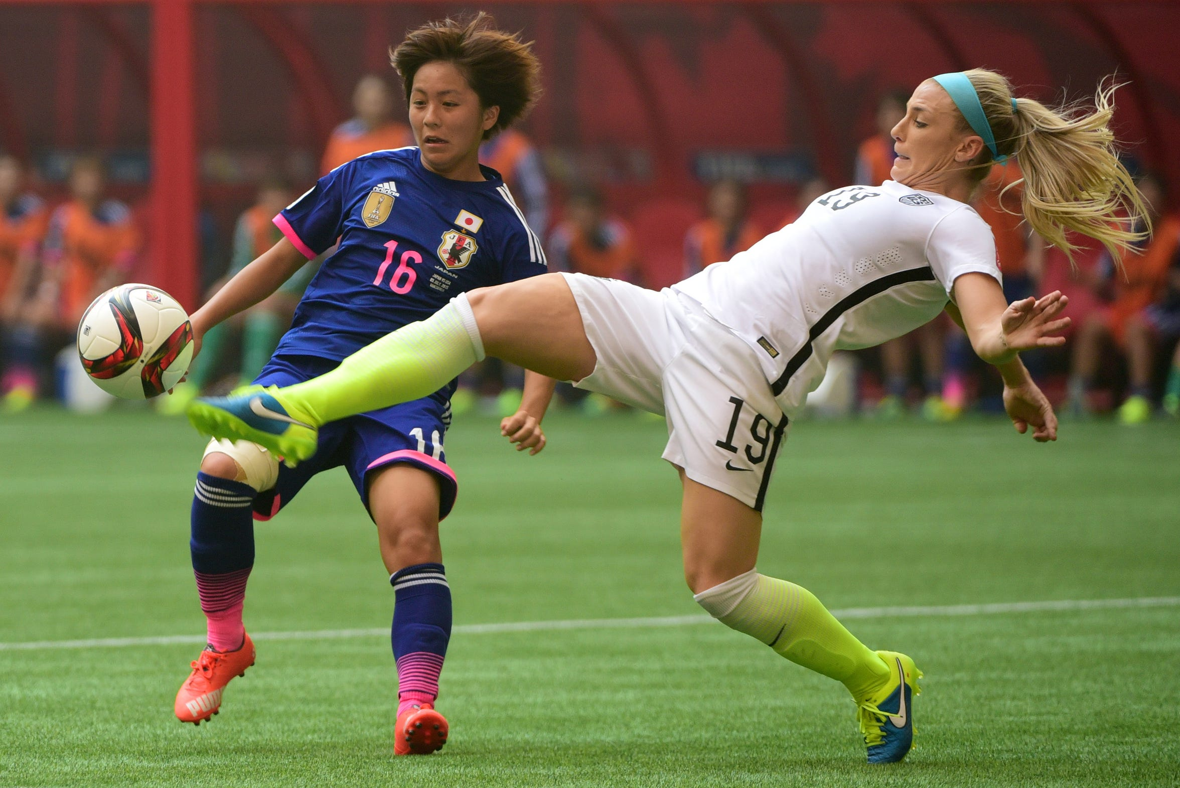 Julie Johnston stretches out to make a play on the ball during the second half of U.S.'s victory over Japan to win the 2015 World Cup.