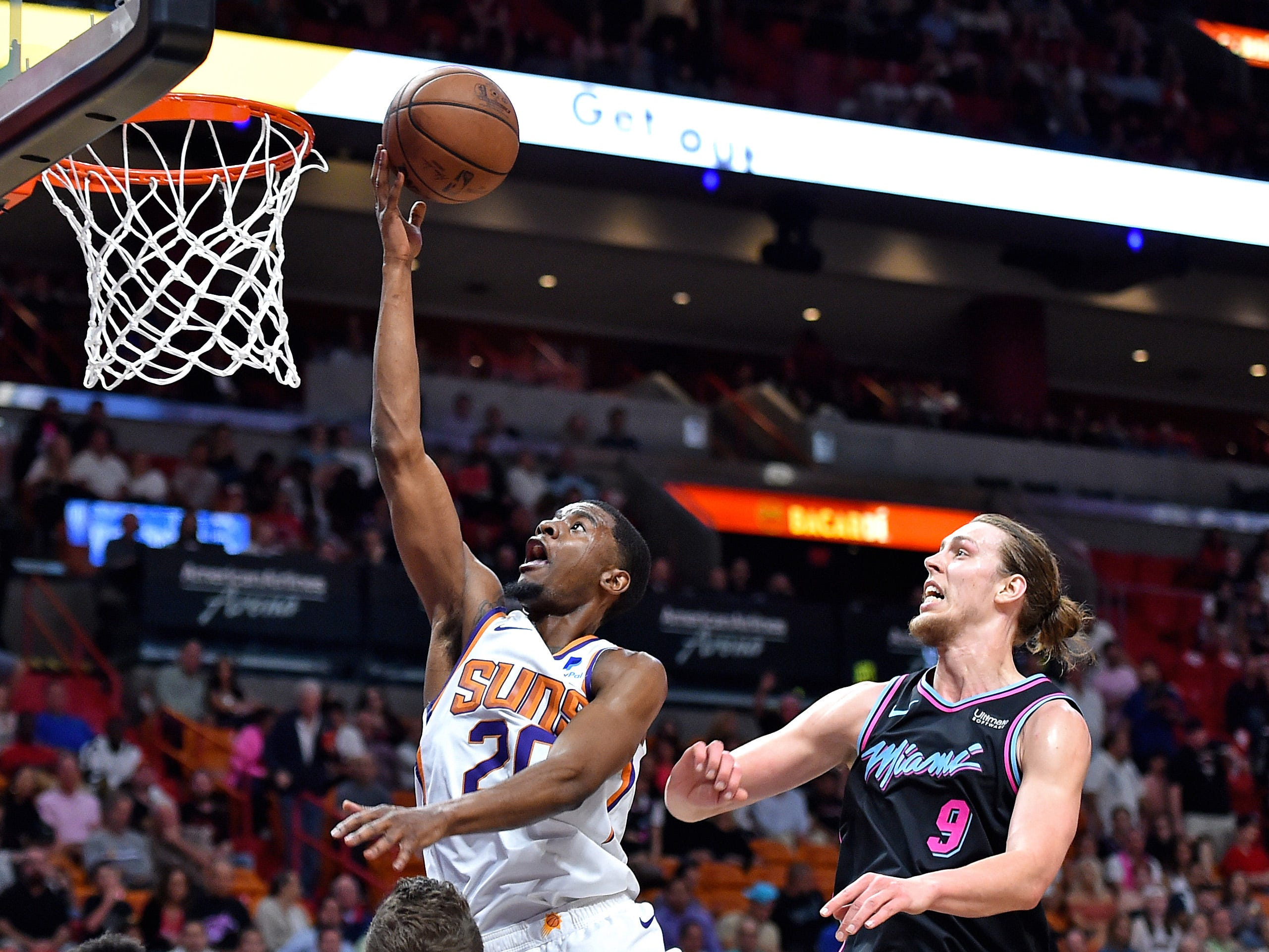 Feb 25, 2019; Miami, FL, USA; Phoenix Suns forward Josh Jackson (20) drives to the basket as Miami Heat forward Kelly Olynyk (9) defends the play during the first half at American Airlines Arena. Mandatory Credit: Steve Mitchell-USA TODAY Sports