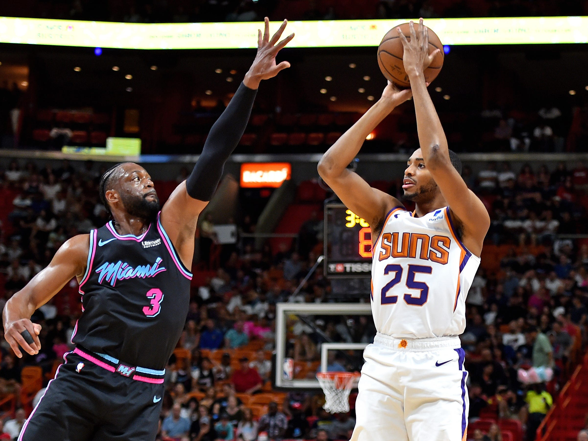 Feb 25, 2019; Miami, FL, USA; Miami Heat guard Dwyane Wade (3) applies pressure to Phoenix Suns forward Mikal Bridges (25) during the first half at American Airlines Arena. Mandatory Credit: Steve Mitchell-USA TODAY Sports