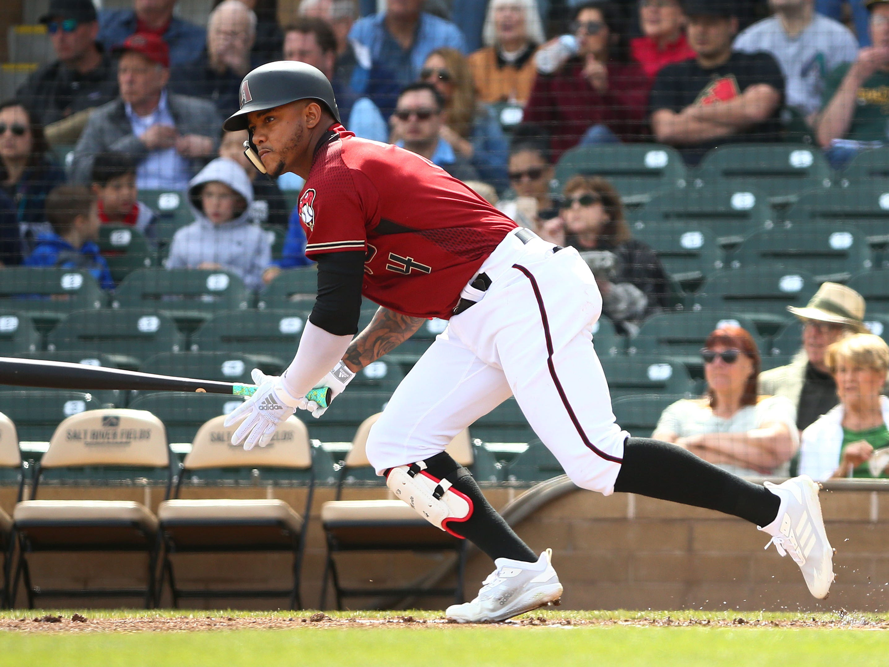 Arizona Diamondbacks Ketel Marte (4) hits a single against the Oakland A's in the first inning during a spring training game on Feb. 25, 2019 at Salt River Fields in Scottsdale, Ariz.
