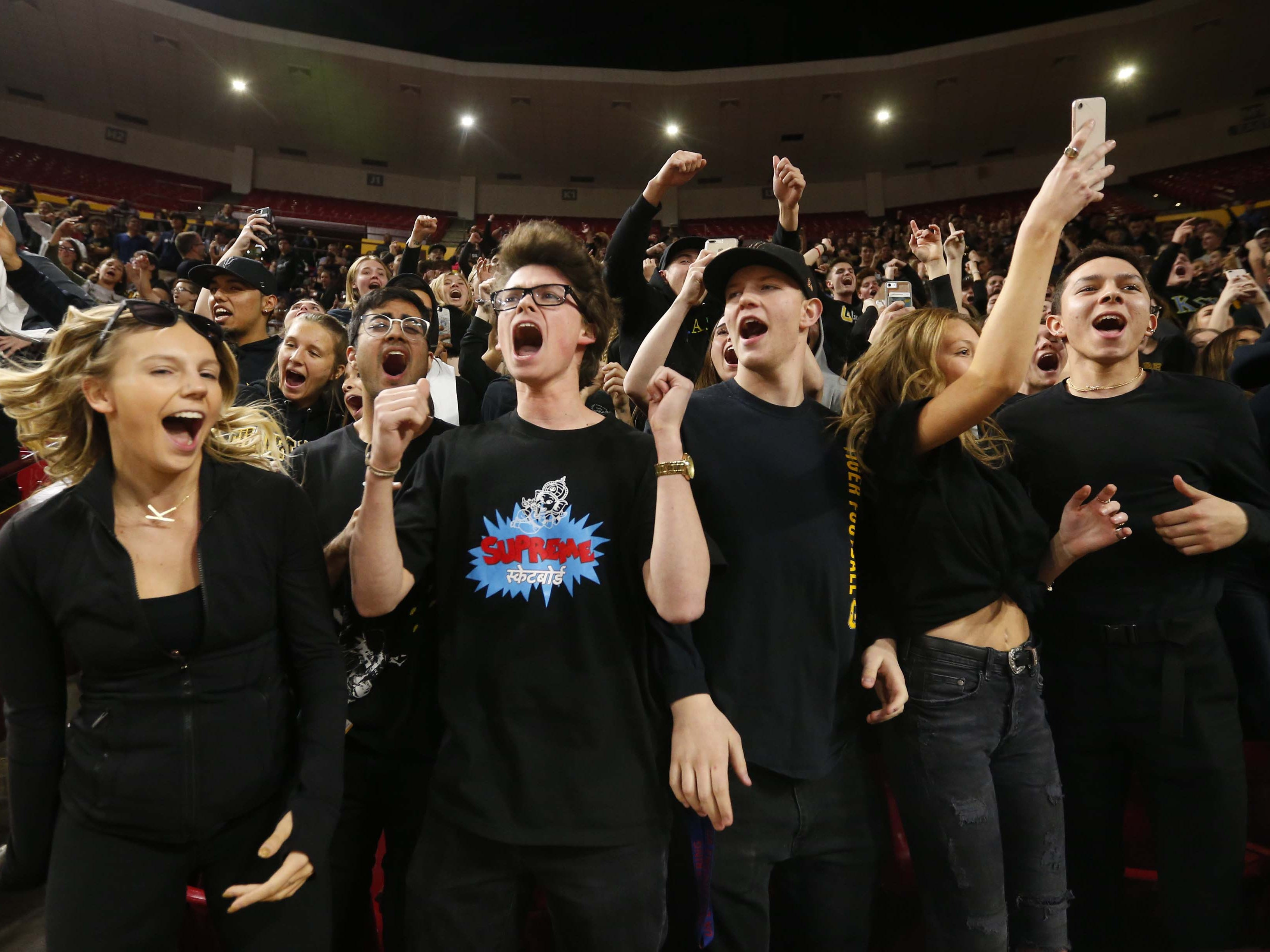 Gilbert students cheer during the Boys State 5A Championship game against Millennium in Tempe, Ariz. Feb. 25, 2019.
