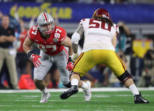 Ohio State defensive end Nick Bosa (97) looks for a way around USC tackle Toa Lobendahn on Dec. 29, 2017.
