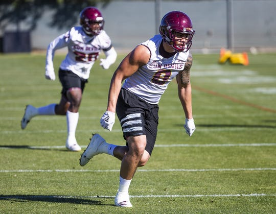 The Arizona State University football team practiced in Tempe, Tuesday, February 26, 2019.   Linebacker Merlin Robertson runs drills during practice.