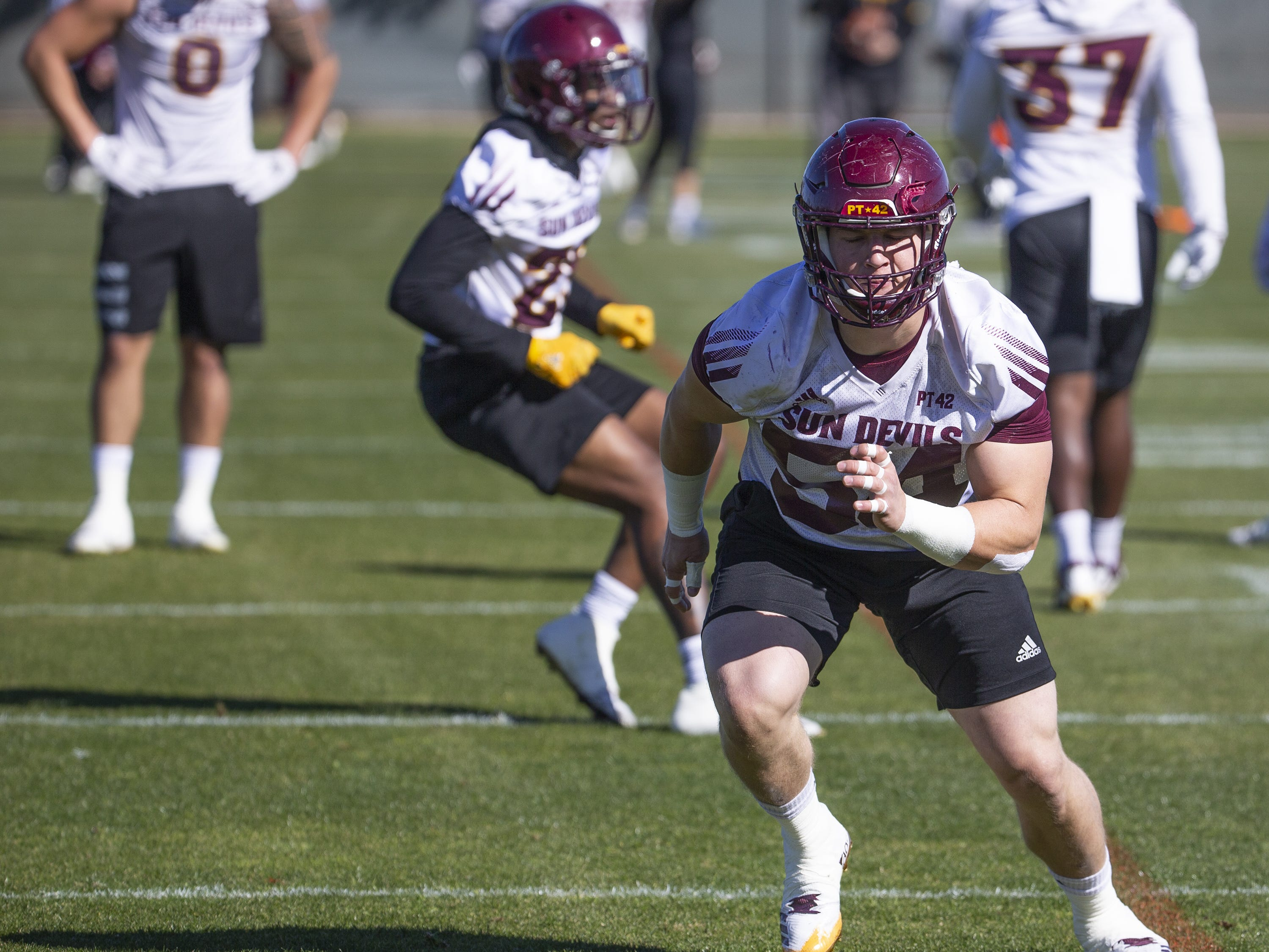 The Arizona State University football team practiced in Tempe, Tuesday, February 26, 2019.   Linebacker Case Hatch runs drills during practice.