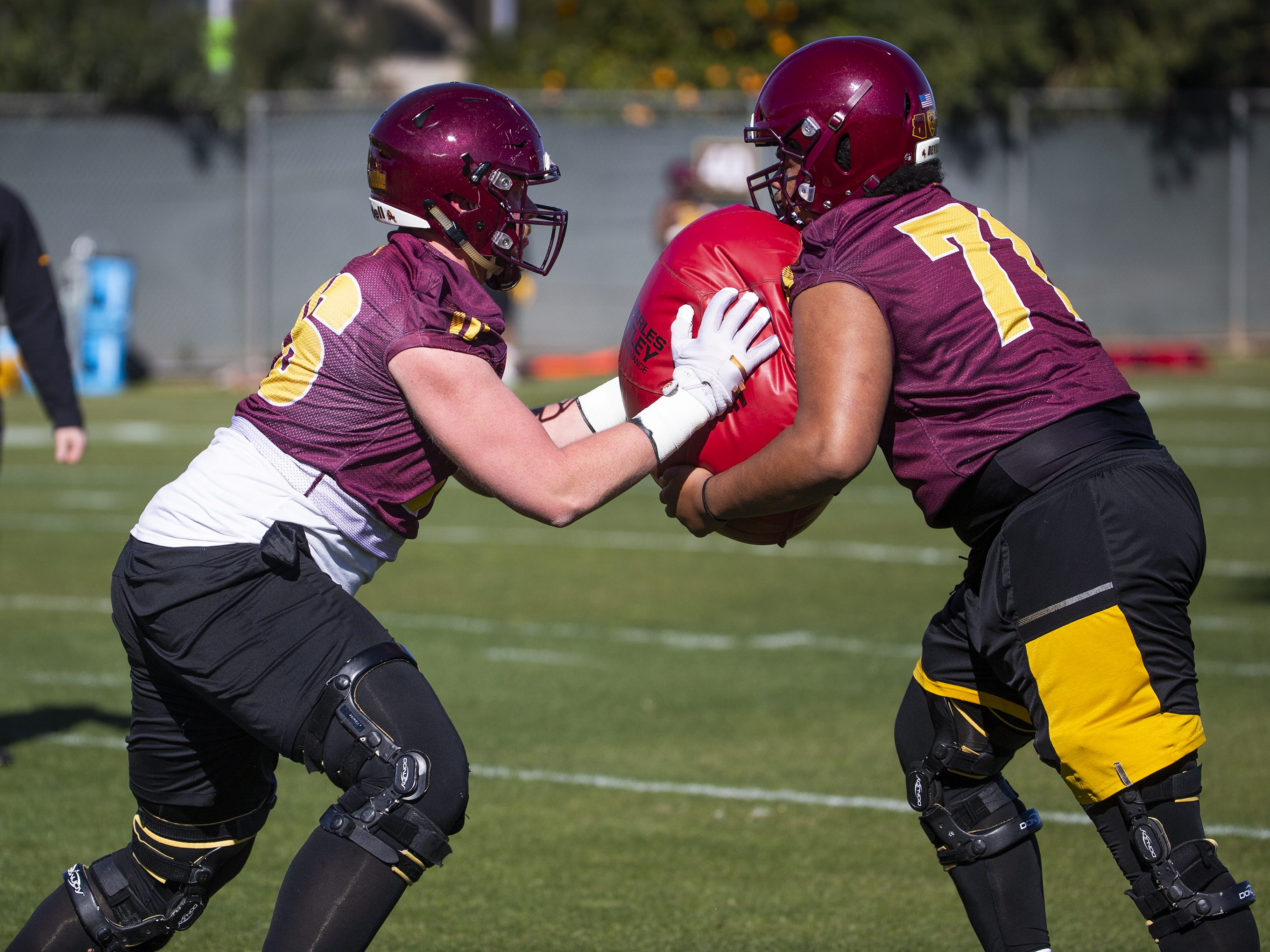 The Arizona State University football team practiced in Tempe, Tuesday, February 26, 2019.   Offensive linemen Spencer Lovell, left, and Steven Miller collide during practice.