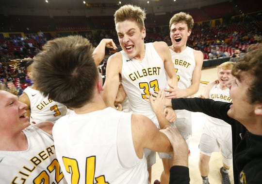 Gilbert's Paul Maldonado (24), Carson Towt (33) and Jake Ehmann (4) celebrate with teammates after winning the Boys State 5A Championship game against Millennium in Tempe, Ariz. Feb. 25, 2019.