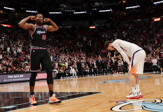 Miami Heat center Bam Adebayo (13) and Phoenix Suns guard Tyler Johnson, right, react during the second half of an NBA basketball game Monday, Feb. 25, 2019, in Miami. (AP Photo/Brynn Anderson)