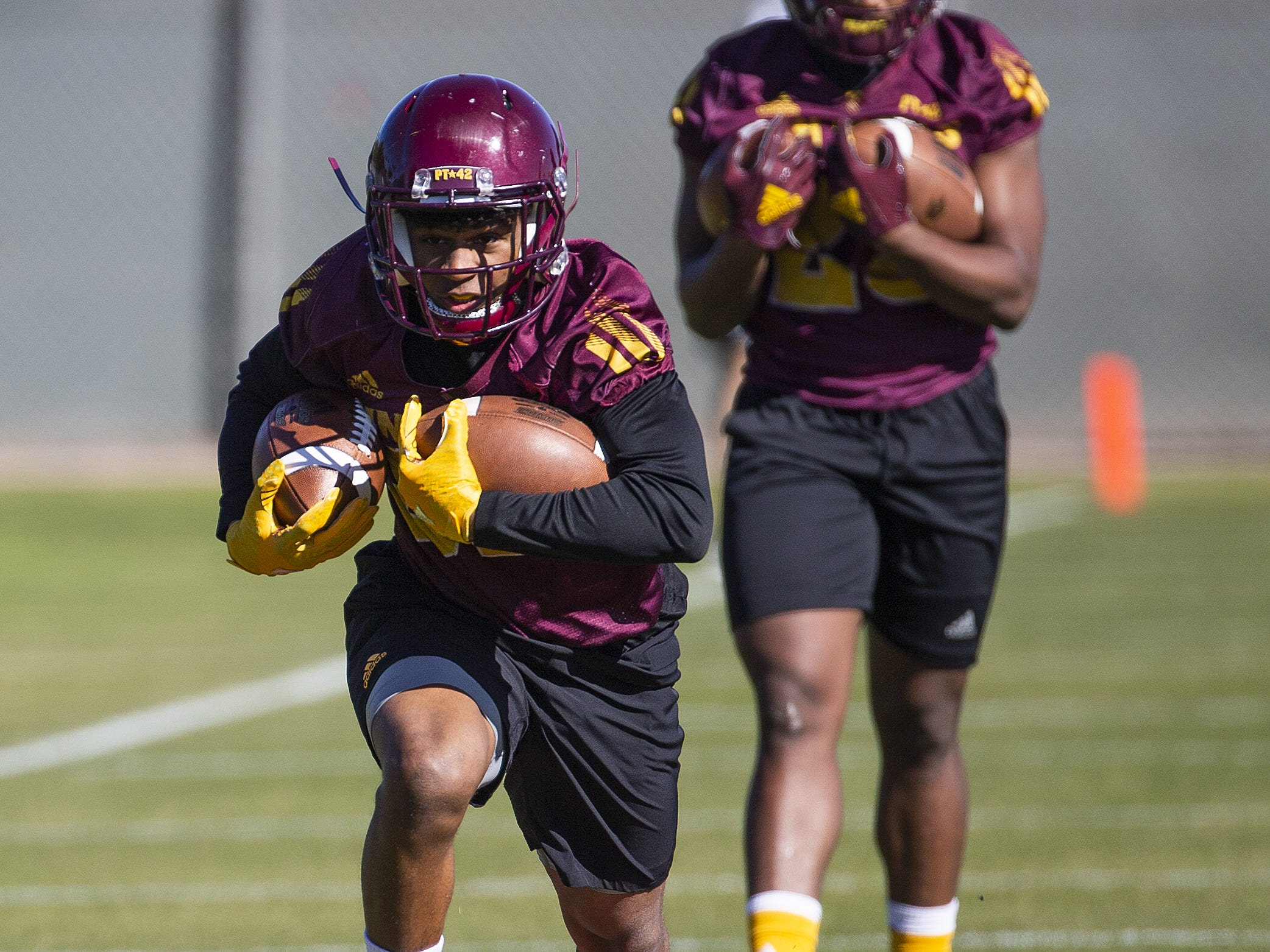 The Arizona State University football team practiced in Tempe, Tuesday, February 26, 2019.   Running back Paul Lucas runs a course during drills.