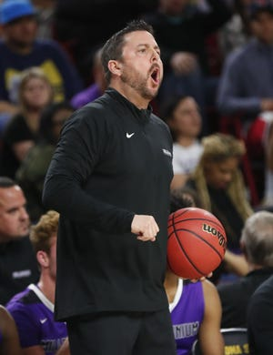 Millennium head coach Ty Amundsen directs his team against Gilbert during the Boys State 5A Championship game in Tempe, Ariz. Feb. 25, 2019.