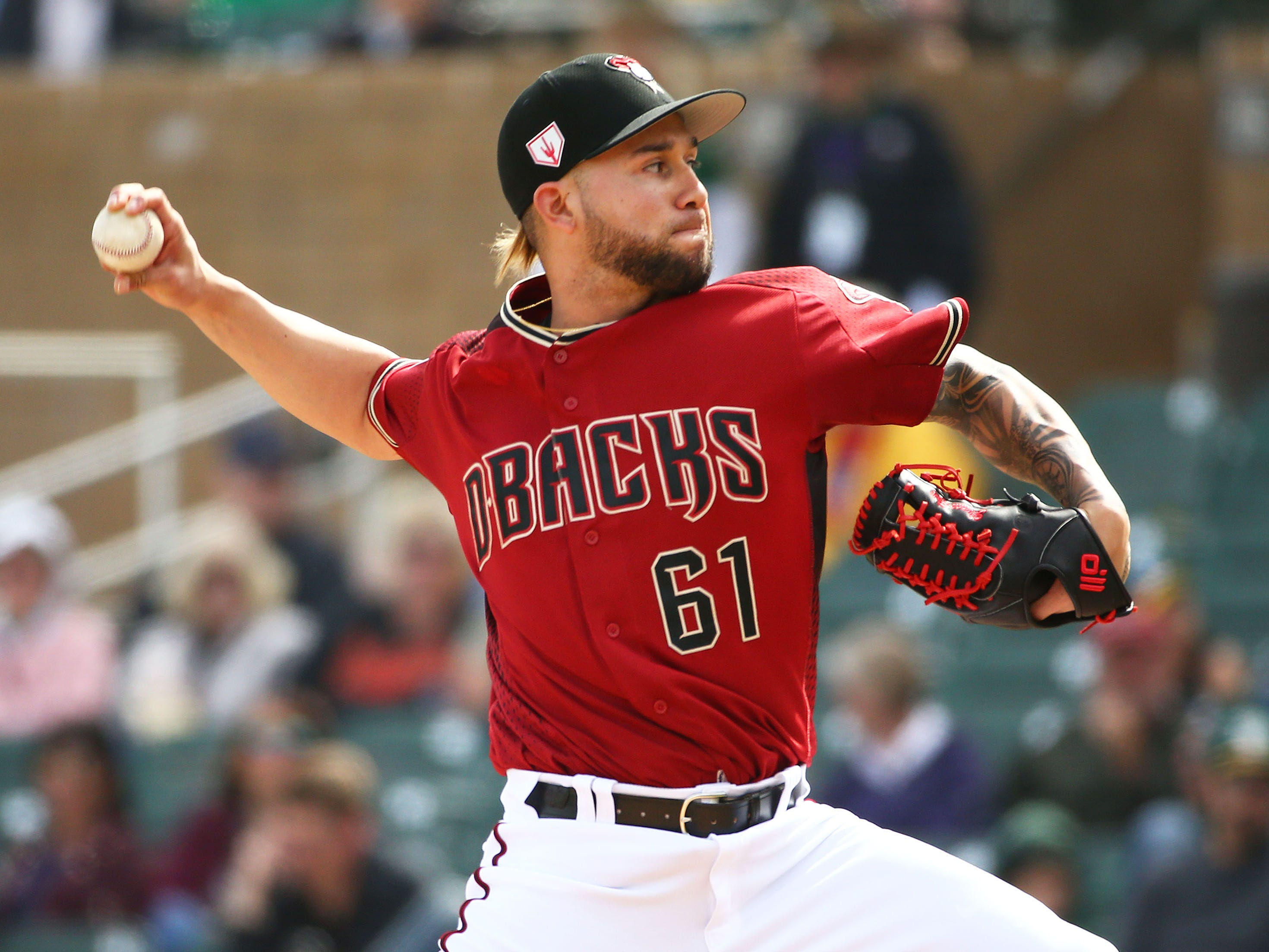 Arizona Diamondbacks pitcher Silvino Bracho (61) throws to the Oakland A's in the third inning during a spring training game on Feb. 25, 2019 at Salt River Fields in Scottsdale, Ariz.