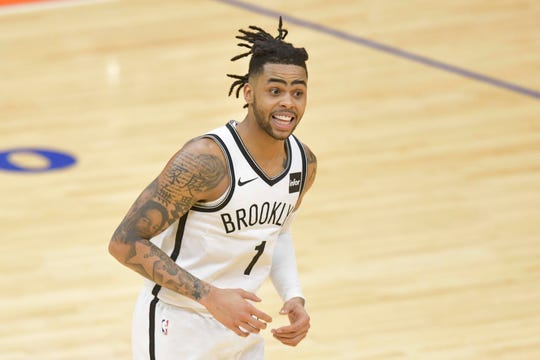 The Nets' D'Angelo Russell is tight with the Suns' Devin Booker.