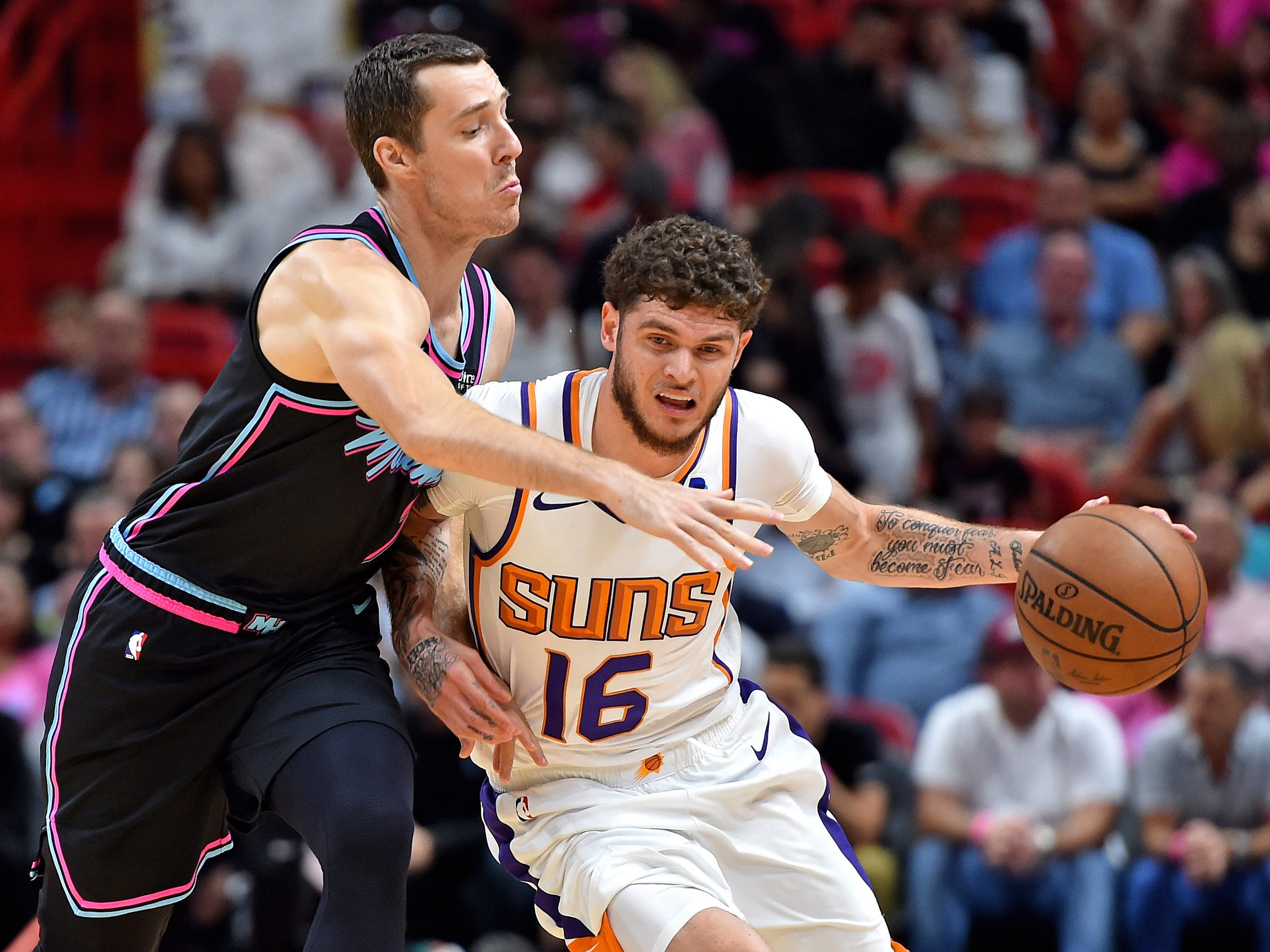 Feb 25, 2019; Miami, FL, USA; Phoenix Suns guard Tyler Johnson (16) is guarded by Miami Heat guard Goran Dragic (7) during the first half at American Airlines Arena. Mandatory Credit: Steve Mitchell-USA TODAY Sports