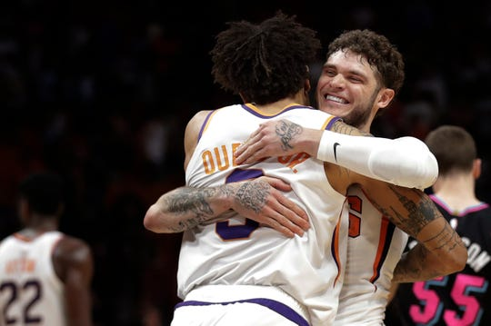 Suns guard Tyler Johnson hugs forward Kelly Oubre Jr. after a victory over the Heat on Feb. 25.