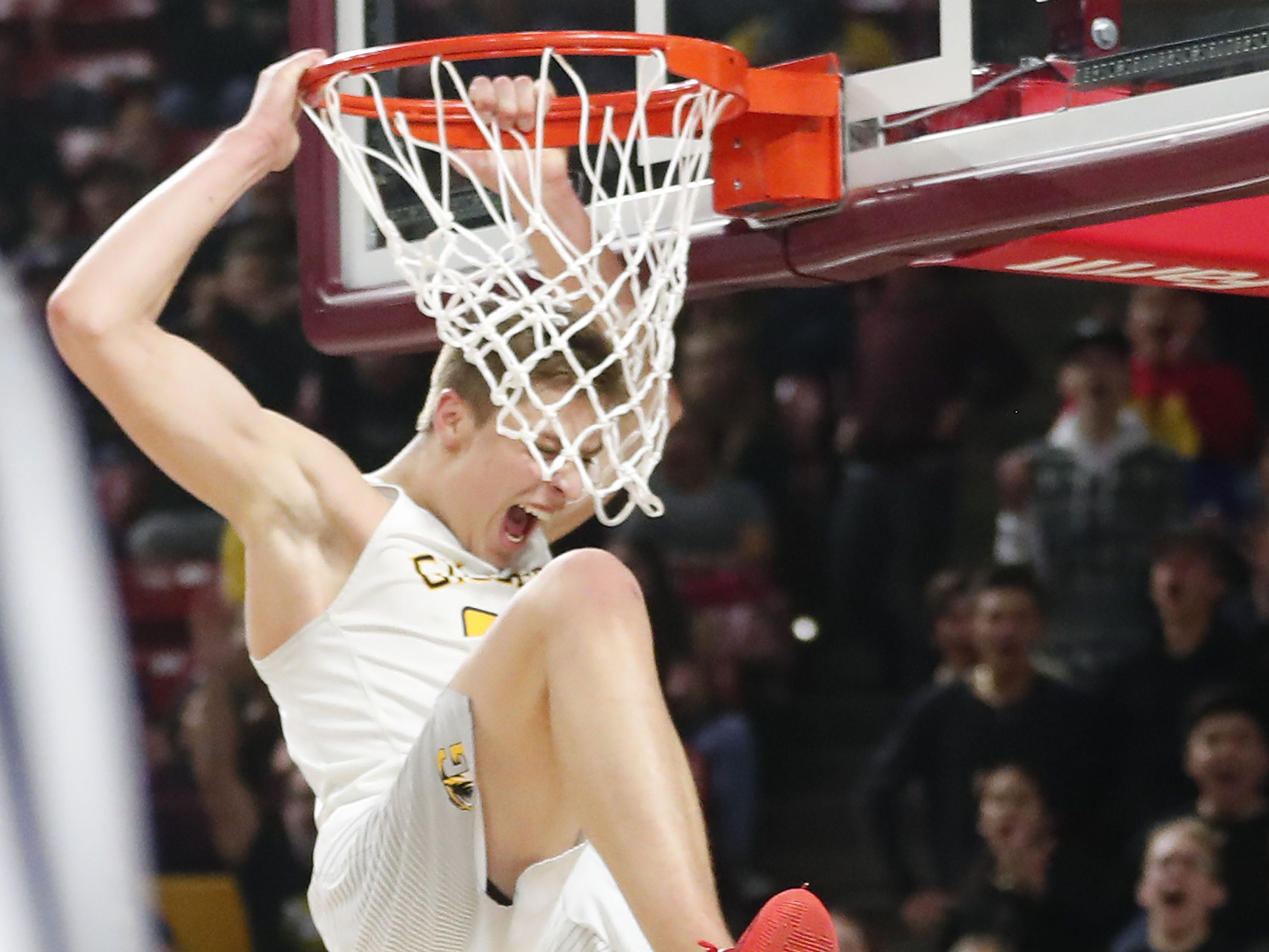 Gilbert's Carson Towt (33) dunks against Millennium during the Boys State 5A Championship game in Tempe, Ariz. Feb. 25, 2019.
