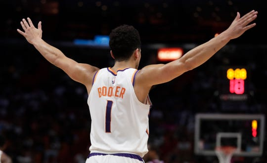 Phoenix Suns guard Devin Booker (1) in action during the second half of an NBA basketball game agains the Miami Heat on Monday, Feb. 25, 2019, in Miami, Fla. (AP Photo/Brynn Anderson)