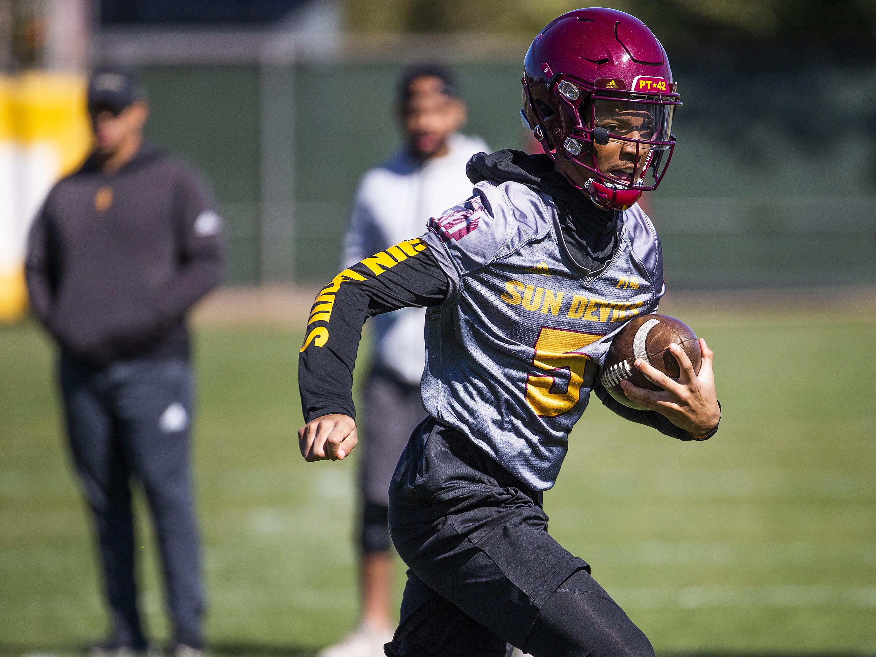 The Arizona State University football team practiced in Tempe, Tuesday, February 26, 2019.   Quarterback Jayden Daniels runs with the ball.