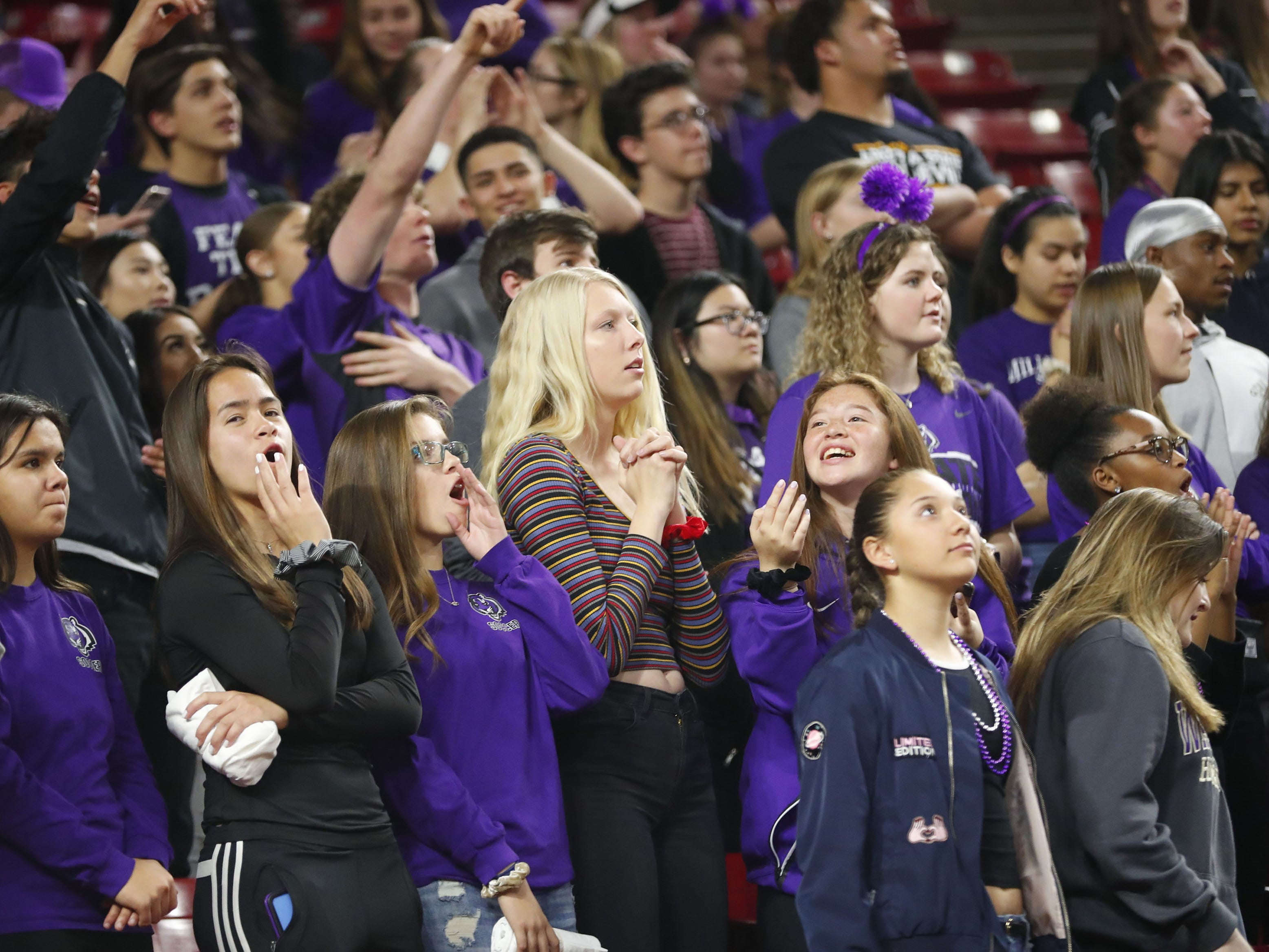 Millennium students cheer against Gilbert during the Girls State 5A Championship game in Tempe, Ariz. Feb. 25, 2019.