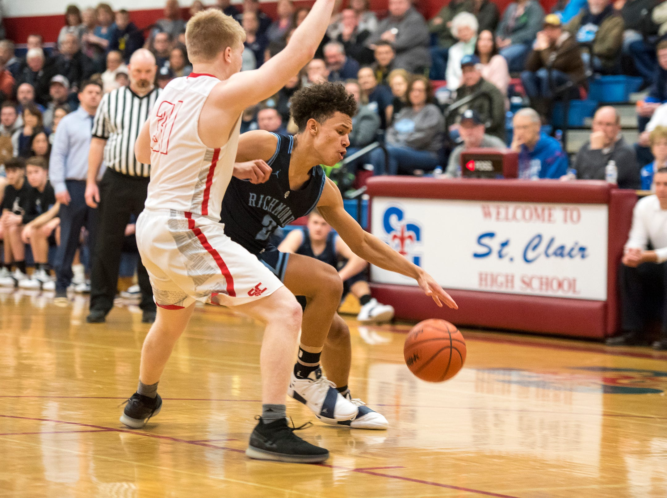 St. Clair's Sean Donaldson (31) guards against Richmond High School guard Drew Davis during the first round of the MHSAA district basketball tournament Monday, Feb. 25, 2019 at St. Clair High School.