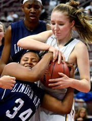York Catholic's Katy Rader, top, battles Linden Hall's Tahri Phillips for a rebound during the District III Class 2A girls' final at the Giant Center in Hershey Tuesday, Feb. 26, 2019. York Catholic lost 56-27. Bill Kalina photo