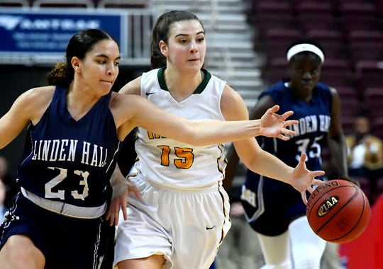 York Catholic's Domenica Martello draws a foul moving the ball up-court against Linden Hall's Anya Miller for a rebound during the District III Class 2A girls' final at the Giant Center in Hershey Tuesday, Feb. 26, 2019. York Catholic lost 56-27. Bill Kalina photo