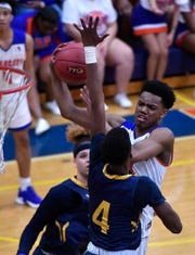 York High's Clovis Gallon Jr. goes up for two while covered by Jonte Simmons of Muhlenberg during the District 3 Class 5-A boy's basketball semifinal game, Monday, February 25, 2019. John A. Pavoncello photo