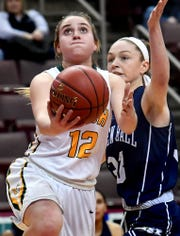 York Catholic's Samantha Bulik drives under the hoop past  Linden Hall's Anna Smale during the District III Class 2A girls' final at the Giant Center in Hershey Tuesday, Feb. 26, 2019. Bill Kalina photo