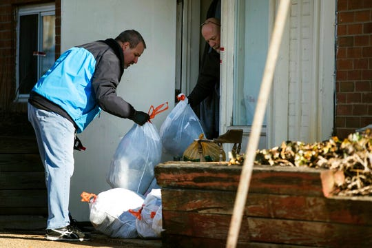 Investigators remove bags from a crime scene at the Robert Morris Apartments in Morrisville, Pa., Tuesday, Feb. 26, 2019. A Pennsylvania woman charged along with her teenage daughter in the deaths of multiple relatives, including children, was arraigned Tuesday on murder charges. The bodies were found Monday inside an apartment at the complex. (AP Photo/Matt Rourke)