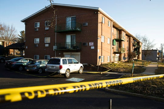 Crime scene tape surrounds the Robert Morris Apartments in Morrisville, Pa., Tuesday, Feb. 26, 2019. A woman and her teenage daughter are facing homicide charges in the deaths of five relatives, including three children, inside an apartment at the complex in suburban Philadelphia, according to authorities. (AP Photo/Matt Rourke)