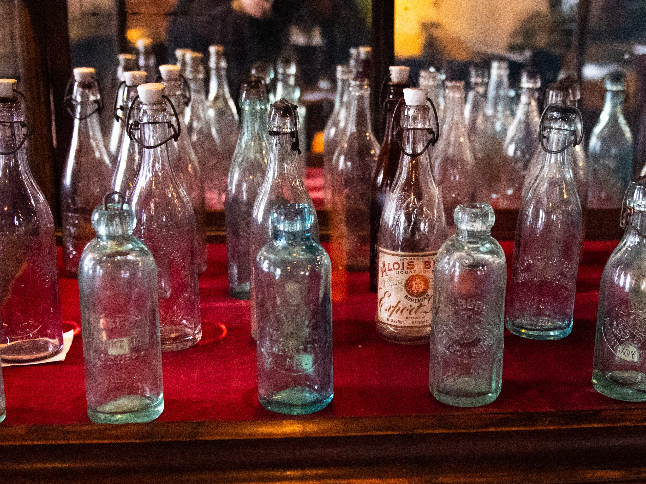The bottles in this case date back many years and are proudly displayed in the Cooper Shed at Bube's Brewery, February 22, 2019.