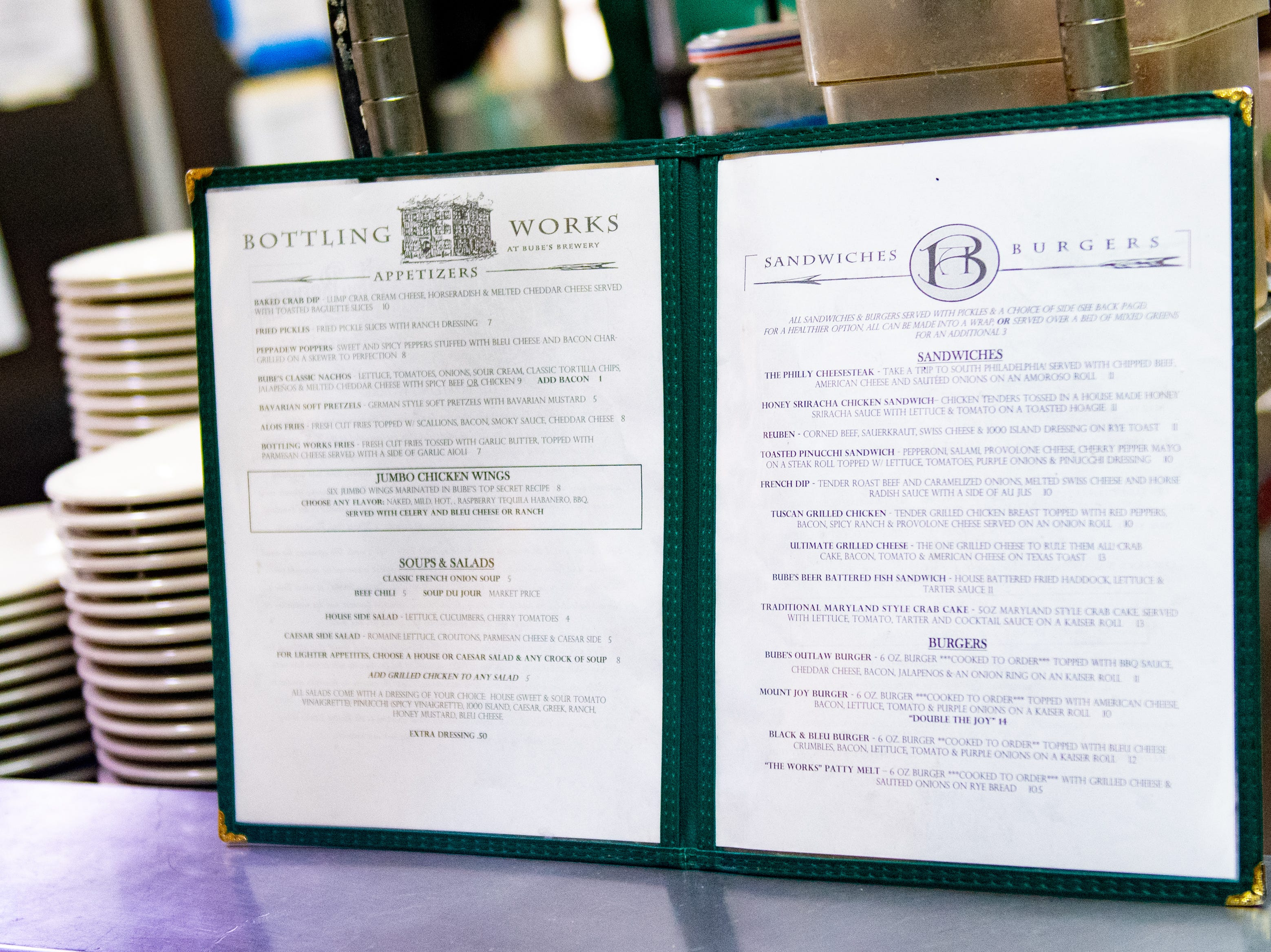 Chefs keep a menu open in the kitchen as a reference, while cooking. New menus are expected to be introduced in March for the Bottling Works, Biergarten, Cooper Shed and Catacombs, February 22, 2019.