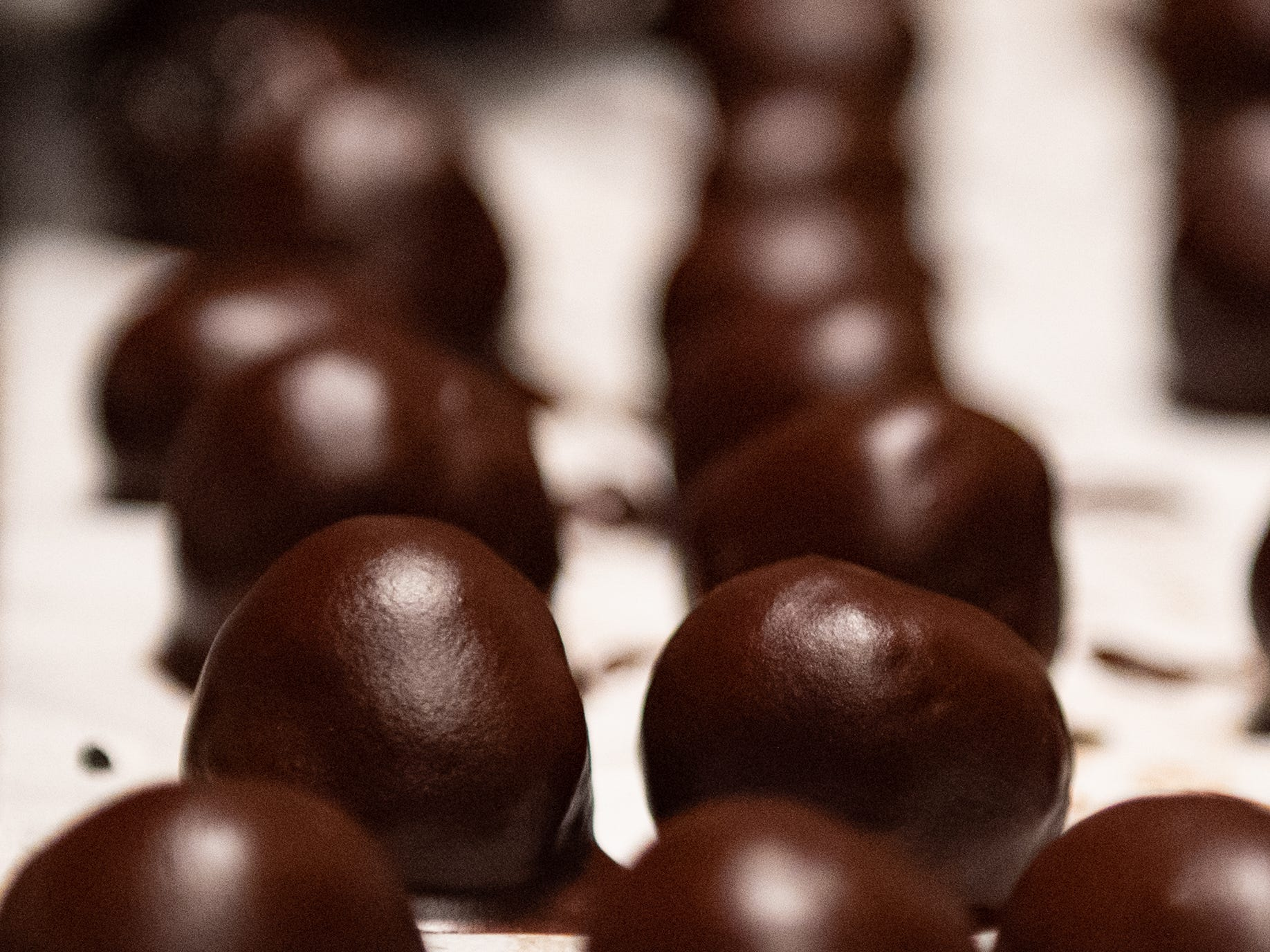 Fresh out of the oven, chocolate-covered truffle balls wait to be plated at Bube's Brewery, February 22, 2019.
