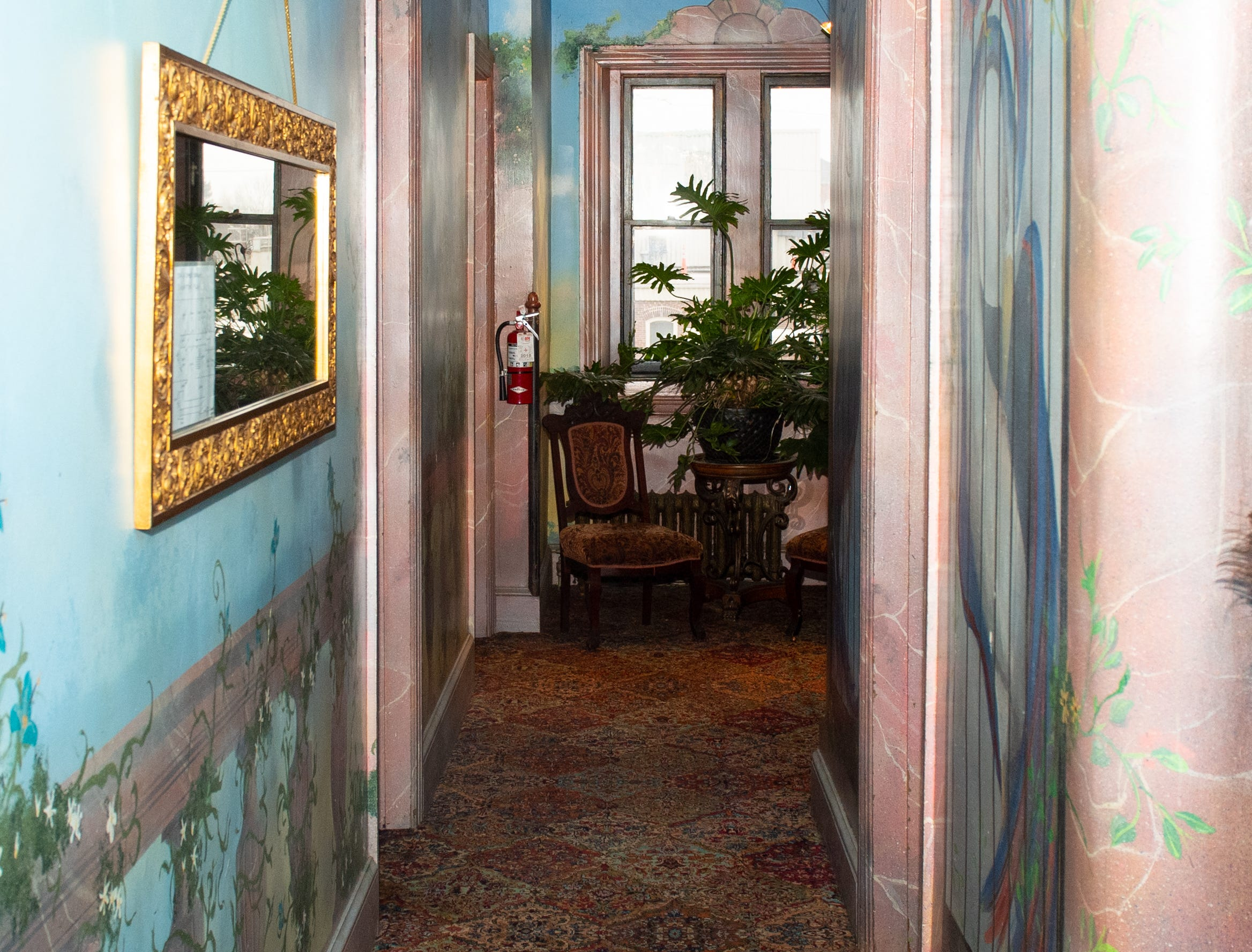 """The hallway inside the Victorian Hotel portion of Bube's Brewery. The third floor of the hotel features 8 speciality themed rooms including a tiki room and a """"dark princess"""" room and a grand suite. February 22, 2019."""