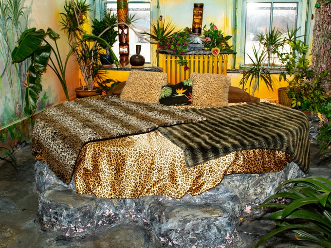 """The """"Jungle"""" room inside the Victorian Hotel portion of Bube's Brewery. Along with the leopard print the room is outfitted with a waterfall and a mini bar. Guests can rent themed rooms for $100/night. February 22, 2019."""