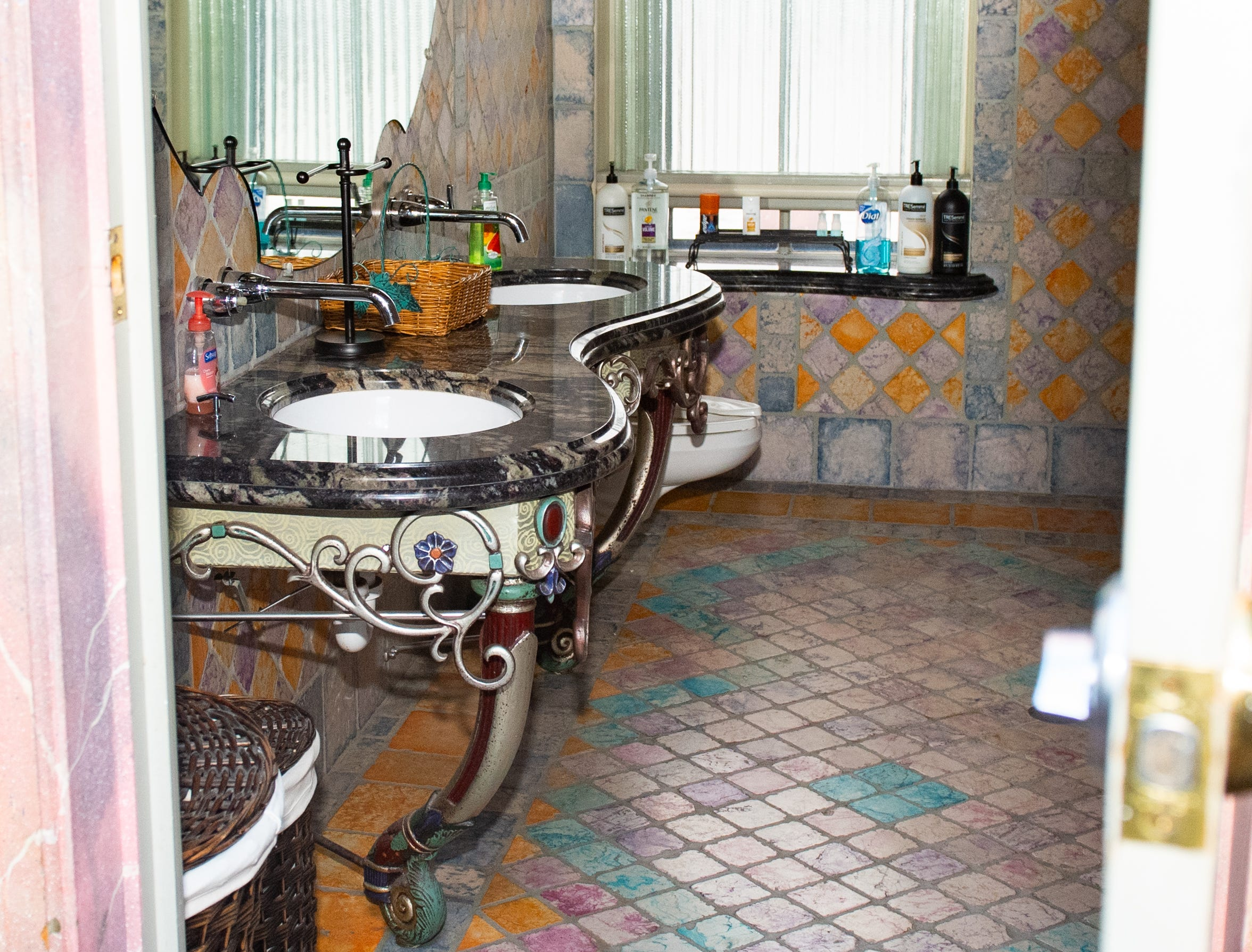 """The shared bathroom on the third floor of the Victorian Hotel adjacent to Bube's Brewery in Mt. Joy. The floor is home to 8 themed rooms like the """"Dark Princess""""  and """"Tiki"""" rooms, February 22, 2019."""