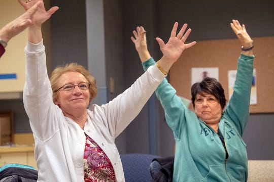 From the left, Claudia Besecker, 66, of Spring Garden Township and Vicky Charley, 67, of Dover Township, do some warm-up exercises during a Matter of Balance class in York Township.