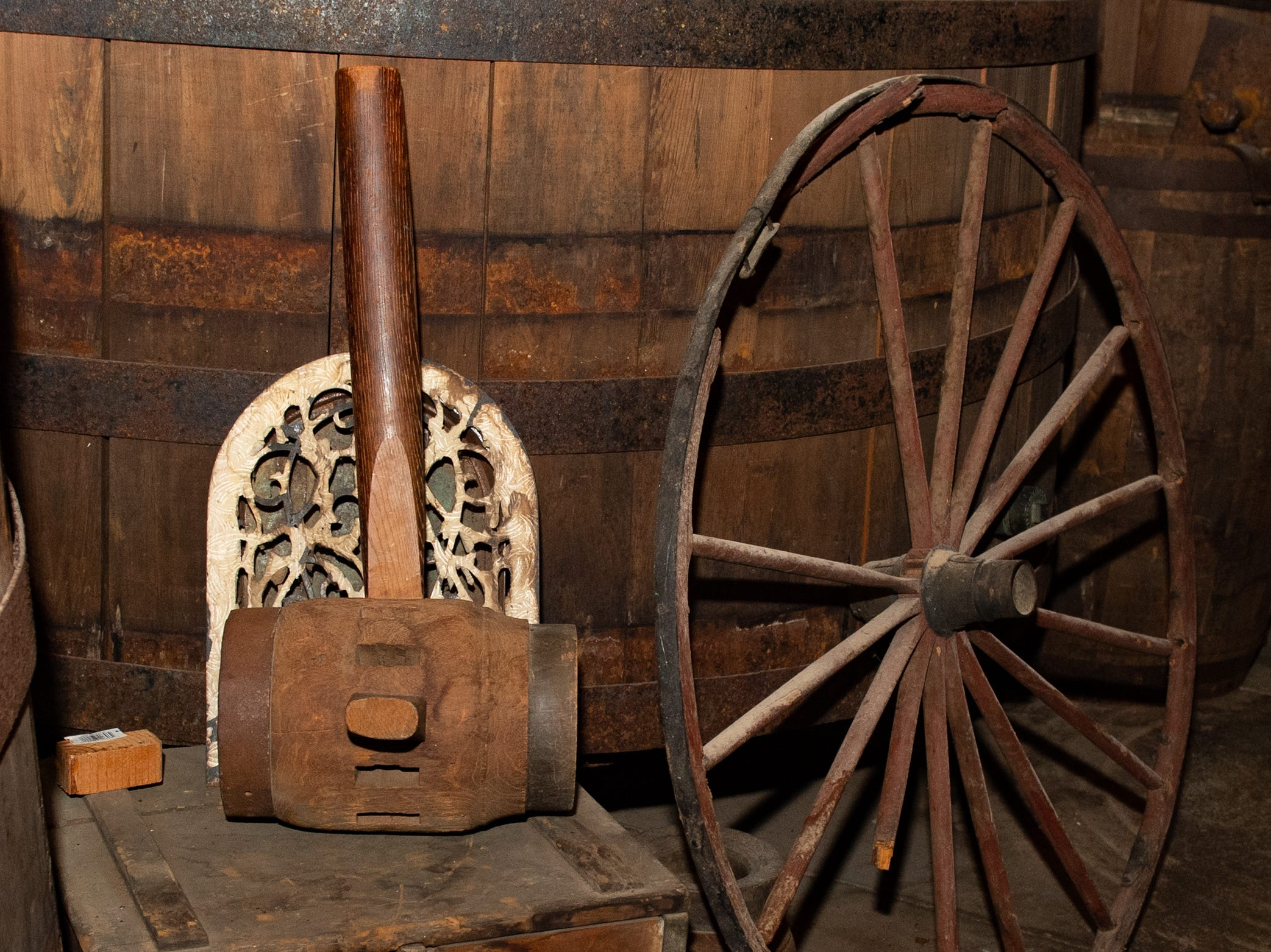 Some old tools and wheels sit along side the barrels at Bube's Brewery, February 22, 2019.