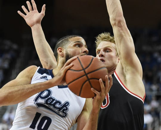 Nevada's Caleb Martin goes up to shoot with Fresno's Sam Bittner covering him in the first half of Saturday's game at Lawlor Events Center.