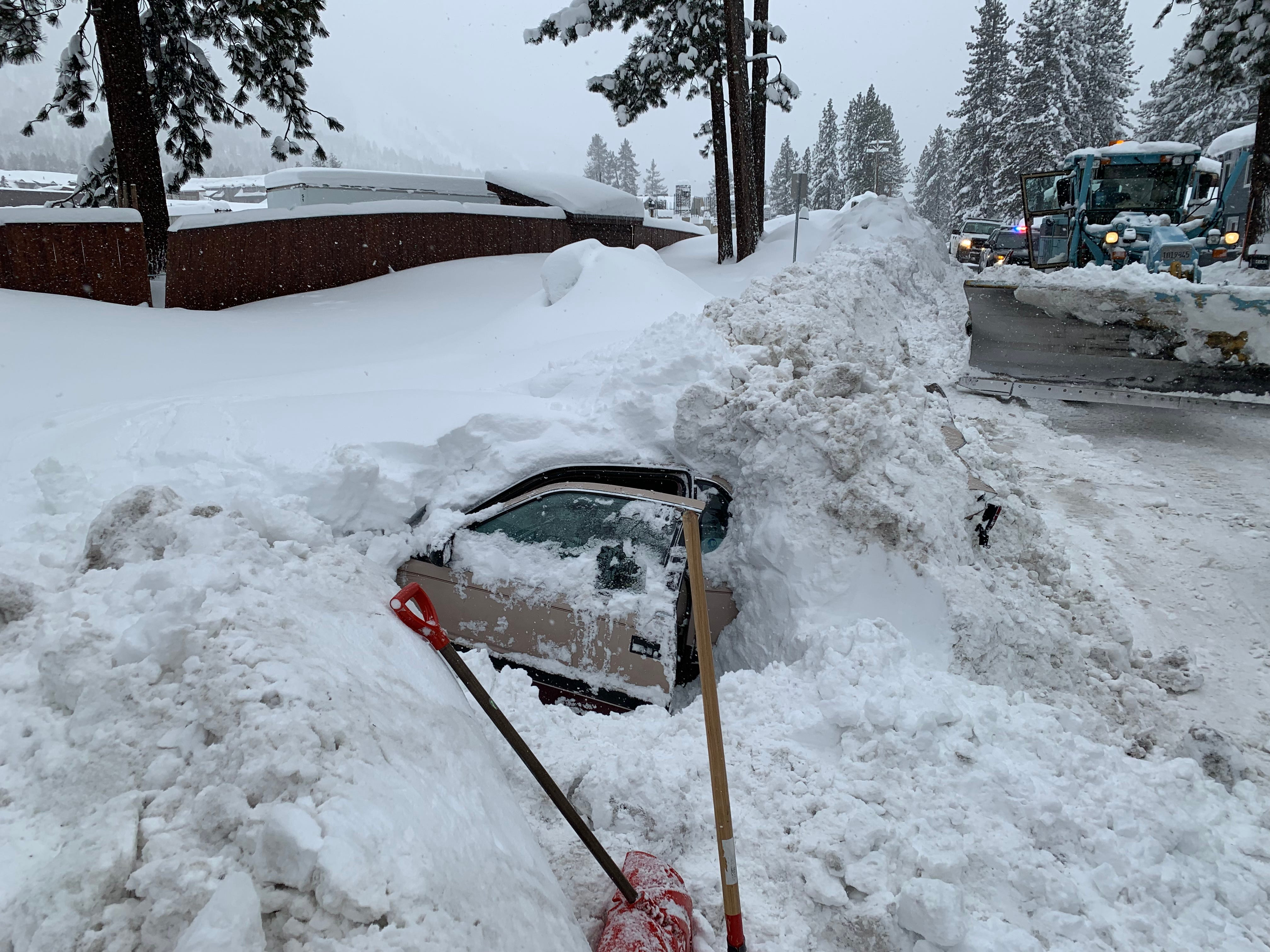 Snowplow strikes buried car in Tahoe, police find woman alive and well inside