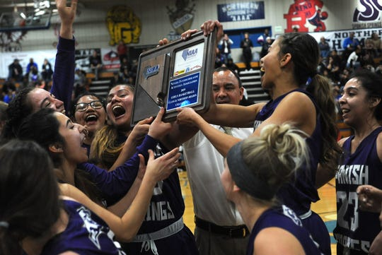 Spanish Springs celebrates after defeating Reno to win the Northern Region Basketball Championship game in Carson City on Feb. 23.