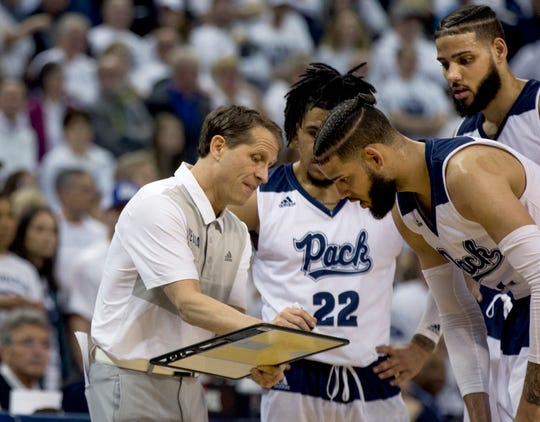 Nevada head coach Eric Musselman draws up a play against Fresno State in the second half  Saturday.