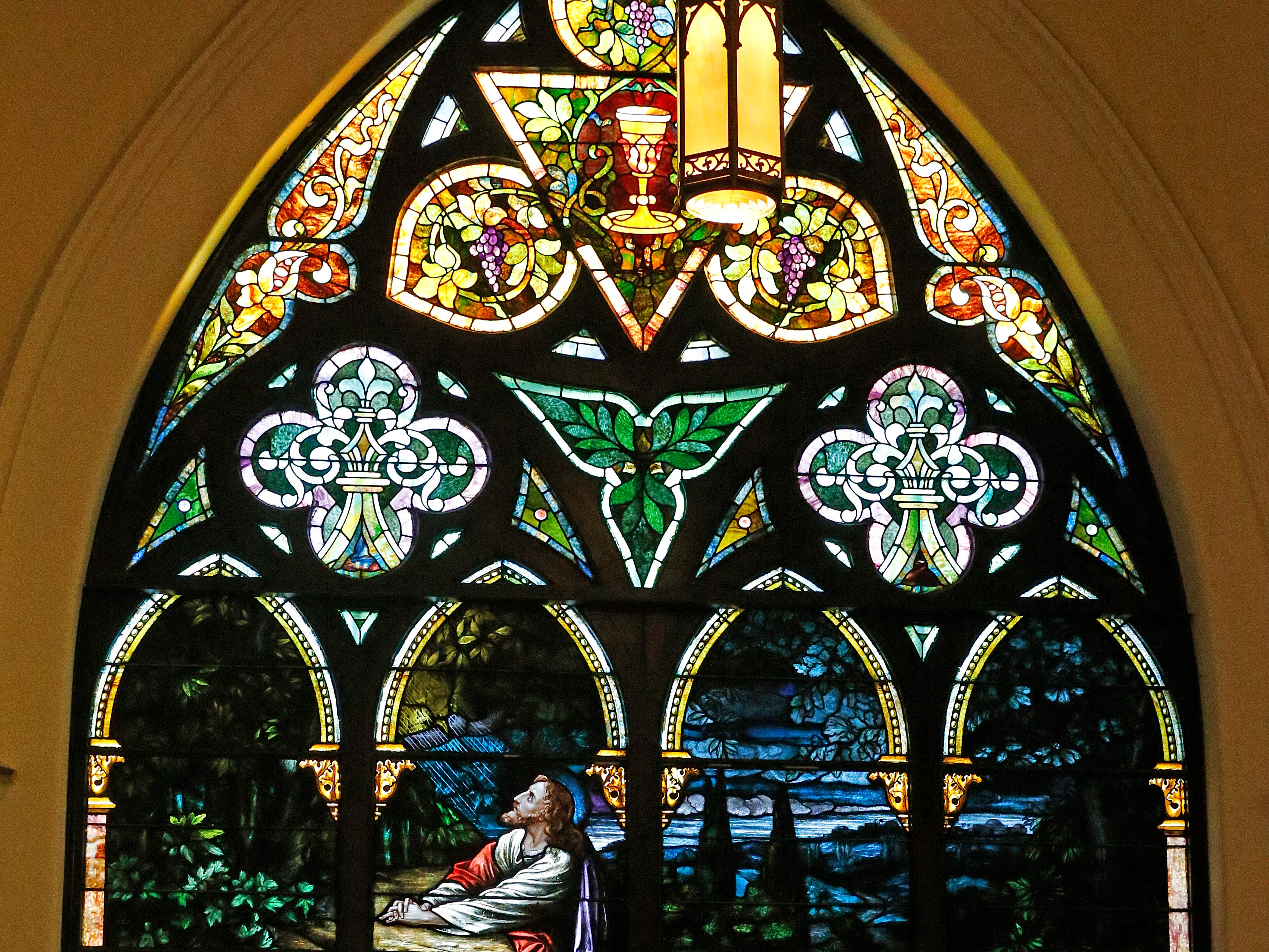 One of the stained-glass windows inside St. John Lutheran Church at the corner of South Seventh and E streets in Richmond.