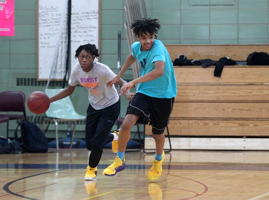 Kaori Barley, left, works on the fast break during practice with teammate Dyllon Scott.