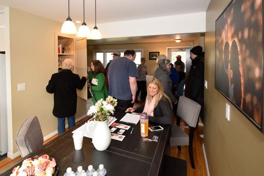 Agent Kaylee Moody of the Angie Flack Brown Team at Keller Williams works at a busy open house in Fairport during last week's wind storm.