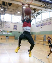 East's Zecharia Harris-Scott dunks during practice. Harris-Scott is a transfer from UPrep.