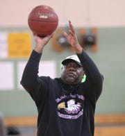 Longtime East head coach Darrell Barley shoots a series of jump shots before practice. Barley has two sons and two nephews playing for the top-seeded Eagles this season.