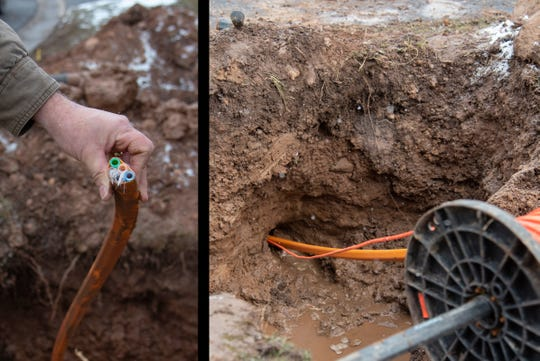 Fiber optic cable conduits are buried underground along the curb on Dorsetwood Drive in Greece on Tuesday, Feb. 26, 2019. Greenlight Networks began working on installing fiber optic internet in Greece this month.