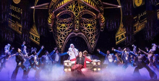 """Red Concepción (center) as The Engineer and the company perform """"American Dream"""" in """"Miss Saigon."""""""